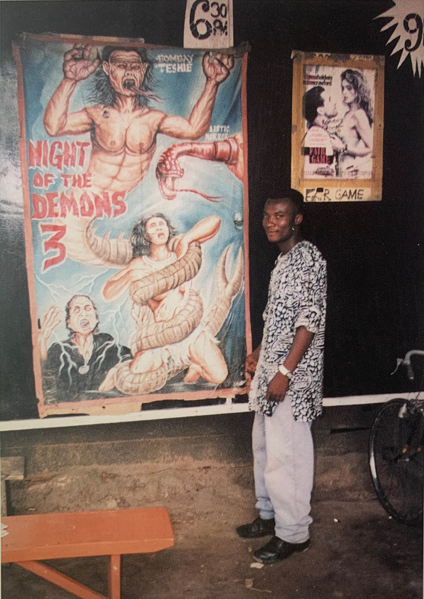 Heavy J. in front of his poster advertising Night of the Demons 3, 1998